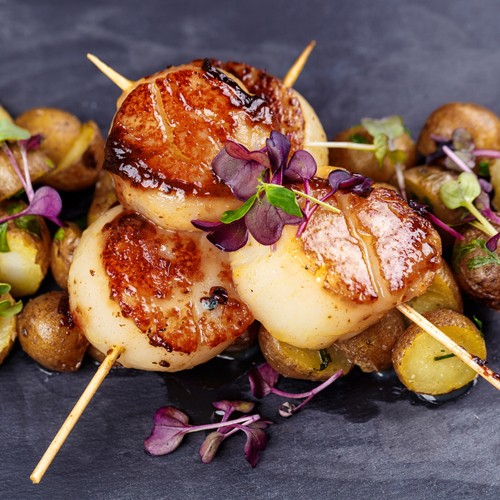 Seared scallops with a soy, honey & orange sauce
